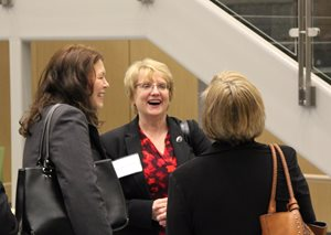 Chief Justice Lori Gildea laughs with community members